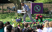 United States President Barack Obama reads the book,WHERE THE WILD THINGS ARE, at the reading nook at  the annual Easter Egg Roll on the South Lawn of the White House on April 21, 2014.  <br /> Credit: Dennis Brack / Pool via CNP