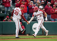 NWA Democrat-Gazette/BEN GOFF @NWABENGOFF<br /> Casey Opitz, Arkansas catcher, low-fives third base coach Nate Thompspon after he hit a 2 RBI home run in the 2nd inning vs LSU Thursday, May 9, 2019, at Baum-Walker Stadium in Fayetteville.