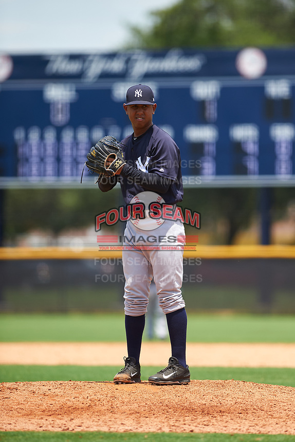 GCL Yankees East relief pitcher Edward Paredes (24) looks in for the sign during the second game of a doubleheader against the GCL Yankees West on July 19, 2017 at the Yankees Minor League Complex in Tampa, Florida.  GCL Yankees West defeated the GCL Yankees East 3-1.  (Mike Janes/Four Seam Images)