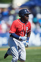 New Hampshire Fisher Cats left fielder Dwight Smith Jr. (25) runs to first base during a game against the Reading Fightin Phils on June 6, 2016 at FirstEnergy Stadium in Reading, Pennsylvania.  Reading defeated New Hampshire 2-1.  (Mike Janes/Four Seam Images)