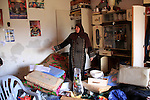 A Palestinian woman inspects damaged room after Israeli army stormed her house, arrested four of her sons in the West Bank village of Awarta near Nablus on March 12, 2011. The Israeli army arrested at least 18 Palestinians in the vicinity of Nablus city in the West Bank as the army searching for suspects of killing five settlers in a nearby Jewish settlement, Palestinian witnesses said Saturday. Photo by Wagdi Eshtayah