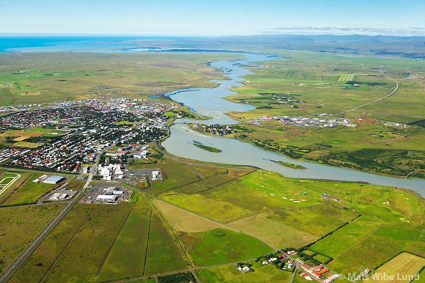 Selfoss og Ölfusá séð til suðvesturs, Laugardælir í forgrunni, Sveitarfélagið Árborg /  Selfoss and Olfusa river viewing southwest. Laugardaelir in foreground, Sveitarfelagid Arborg.