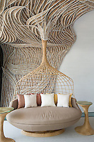 A fantasy sofa has been created in the bedroom of the Villa Siam in Iniala