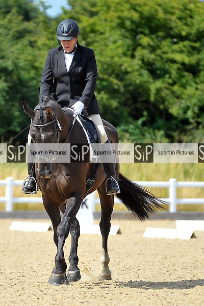 Class 6. British Dressage. Brook Farm Training Centre. Essex. 19/07/2015. MANDATORY Credit Ellie Ingram/Sportinpictures - NO UNAUTHORISED USE - 07837 394578