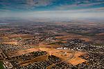 Aerial over growing rural suburban tract housing communities, near Oakley, California