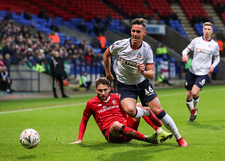 Bolton Wanderers' Pawel Olkowski competing with Walsall's Luke Leahy<br /> <br /> Photographer Andrew Kearns/CameraSport<br /> <br /> Emirates FA Cup Third Round - Bolton Wanderers v Walsall - Saturday 5th January 2019 - University of Bolton Stadium - Bolton<br />  <br /> World Copyright © 2019 CameraSport. All rights reserved. 43 Linden Ave. Countesthorpe. Leicester. England. LE8 5PG - Tel: +44 (0) 116 277 4147 - admin@camerasport.com - www.camerasport.com