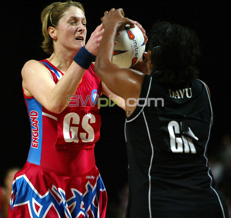Pix: Simon Wilkinson/SWpix.com. International Netball. England v New Zealand. Test Series 2003. MEN Arena. Manchester. 24/02/03..COPYRIGHT PICTURE>>SIMON WILKINSON>>01943 436649>>..England's Alex Astle competes for the ball with Vilamina Davu