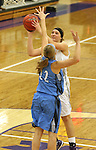 SIOUX FALLS, SD - DECEMBER 5:  Sam Knecht #50 from the University of Sioux Falls shoots over Lauren Buck #22 from Upper Iowa in the second half of their game Friday night at the Stewart Center.  (Photo by Dave Eggen/inertia)