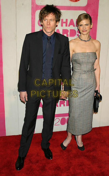 KEVIN BACON & KYRA SEDGWICK.The 14th Annual Gotham Awards, Pier 60, Chelsea Piers, New York City, New York, USA.01December 2004..full length married husband wife tweed strapless dress belted.Ref: IW.www.capitalpictures.com.sales@capitalpictures.com.©Capital Pictures.
