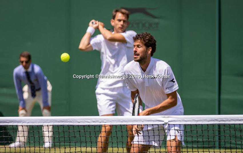 London, England, 4 July, 2019, Tennis,  Wimbledon, Mens doubles: Robin Haase (NED) and Frederik Nielsen (DEN) (L)<br /> Photo: Henk Koster/tennisimages.com