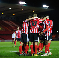 Lincoln City U18's Jordan Adebayo-Smith celebrates scoring his side's fourth goal, his hat-trick, with team-mates<br /> <br /> Photographer Chris Vaughan/CameraSport<br /> <br /> The FA Youth Cup Second Round - Lincoln City U18 v South Shields U18 - Tuesday 13th November 2018 - Sincil Bank - Lincoln<br />  <br /> World Copyright © 2018 CameraSport. All rights reserved. 43 Linden Ave. Countesthorpe. Leicester. England. LE8 5PG - Tel: +44 (0) 116 277 4147 - admin@camerasport.com - www.camerasport.com