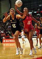 World 7 goalkeep Geva Mentor beats Irene Van Dyk to the ball during the International  Netball Series match between the NZ Silver Ferns and World 7 at TSB Bank Arena, Wellington, New Zealand on Monday, 24 August 2009. Photo: Dave Lintott / lintottphoto.co.nz