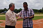 Moises Alou (R) is congratulated by Jorge Perez-Diaz, head of Latin American Oversight for Major League Baseball at the end of the tournament in Boca Chica August 8, 2011 the tournament called Torneo Supremo which aims to maximize the ability of Major League Baseball organizations to scout in the Dominican Republic. El Torneo Supremo will consist of four teams playing one game per week in addition to a mid-tournament All-Star event, as well as championship and consolation games. August  2011. ViewPress/ ZZ