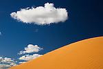 Australia, Queensland, Simpson Desert; red sand dune and cumulus could