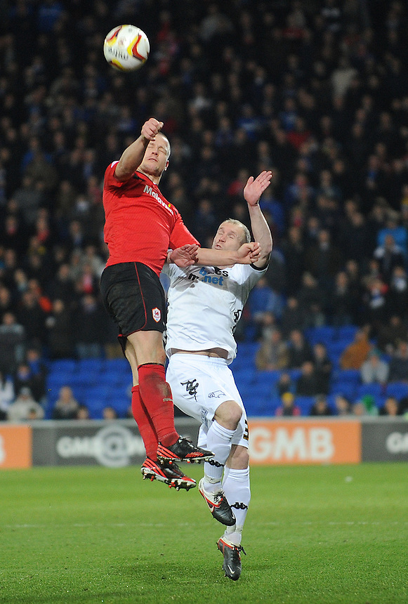 Cardiff City's Heidar Helguson and Derby's Gareth Roberts collide while jumping for the header ..Football - npower Football League Championship - Cardiff City v Derby County - Tuesday 05th March 2013 - Cardiff City Stadium - Cardiff..© CameraSport - 43 Linden Ave. Countesthorpe. Leicester. England. LE8 5PG - Tel: +44 (0) 116 277 4147 - admin@camerasport.com - www.camerasport.com