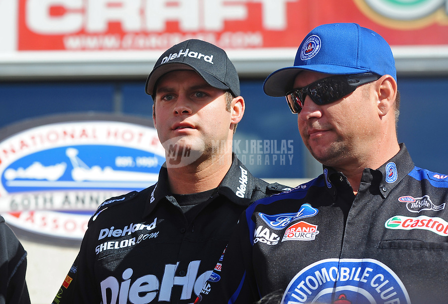 Nov. 13, 2011; Pomona, CA, USA; NHRA funny car driver Matt Hagan (left) and Robert Hight during the Auto Club Finals at Auto Club Raceway at Pomona. Mandatory Credit: Mark J. Rebilas-.