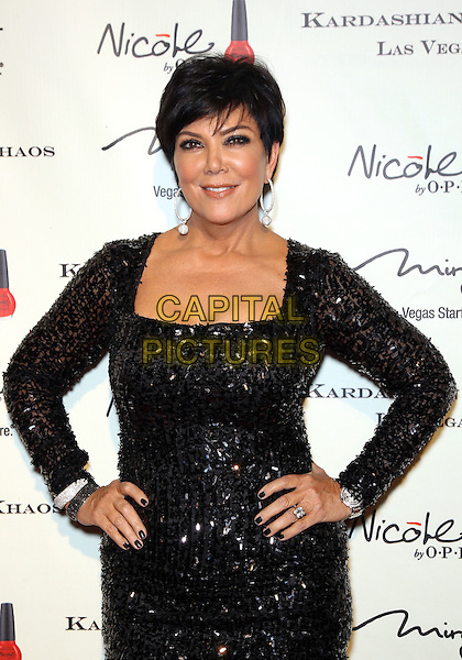 Kris Jenner.The Kardashian Family celebrates the Grand Opening of Kardashian Khaos at The Mirage Hotel and Casino, Las Vegas, Nevada, USA,.15th December 2011..half length black dress sequined sequin hands on hips .CAP/ADM/MJT.© MJT/AdMedia/Capital Pictures.