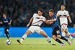 Ricardo Monteolivo of AC Milan competes for the ball with Federico Dimarco of FC Internazionale Milano during the AC Milan vs FC Internazionale Milano as part of the International Champions Cup 2015 at the Longgang Stadium on 25 July 2015 in Shenzhen, China. Photo by Hendrik Frank / Power Sport Images