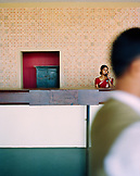 SRI LANKA, Asia, Dambulla, female receptionist talking on phone at Kandalama Hotel