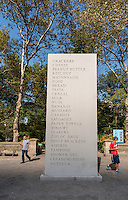"David Shrigley's ""MEMORIAL"" 2016 rises in the Doris C. Freedman Plaza of Central Park in New York on Tuesday, September 13, 2016.  The 17-foot tall granite stle sculpture honors the ephemeral shopping list, carved into its permanent granite, celebrating the commonplace. The exhibit will be in place until February 12, 2017. (© Richard B. Levine)"