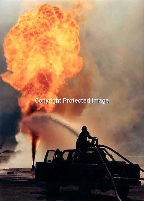 Unidentified firefighters from the USA trying to put out a  burning fire at Burhan oilfields in Kuwait on August 13, 1991 in the aftermath of the Gulf War. President Saddam Hussein of Irak ordered the wells to be destroyed when his troops withdrew from Kuwait. .(Photo Per-Anders Pettersson)
