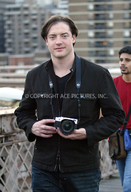 Brendan Fraser spotted on a sight-seeing spree in New York with his point-and-shoot Leica photo camera. New York, August 8, 2004. Please byline: BRIAN FLANNERY--ACEPIXS.COM   ..  *** ***..Ace Pictures, Inc:  ..contact: Alecsey Boldeskul (646) 267-6913 ..Philip Vaughan (646) 769-0430..e-mail: info@acepixs.com