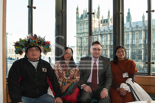 London, England. Chief Almir Narayamoga Surui, Sheyla Yakarepi Juruna, Martin Horwood MP and Ruth Buendia Mestoquiari Ashaninka at Portcullis House with the Houses of Parliament behind during the indigenous people's visit to London to highlight the impact of hydroelectric dams proposed for the rivers of the Amazon basin, 02/03/2011.