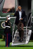 Washington, DC - September 12, 2009 -- United States President Barack Obama disembarks Marine One on the South Lawn of the White House in Washington on September 12, 2009. President Obama traveled to Minneapolis, Minnesota to speak at a rally on health insurance reform.  .Credit: Alexis C. Glenn / Pool via CNP