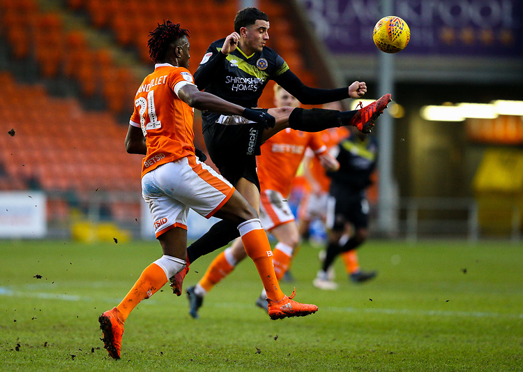 Shrewsbury Town's Oliver Norburn controls under pressure from Blackpool's Armand Gnanduillet<br /> <br /> Photographer Alex Dodd/CameraSport<br /> <br /> The EFL Sky Bet League One - Blackpool v Shrewsbury Town - Saturday 19 January 2019 - Bloomfield Road - Blackpool<br /> <br /> World Copyright &copy; 2019 CameraSport. All rights reserved. 43 Linden Ave. Countesthorpe. Leicester. England. LE8 5PG - Tel: +44 (0) 116 277 4147 - admin@camerasport.com - www.camerasport.com