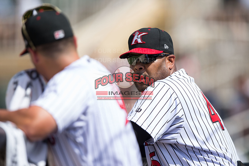 Kannapolis Intimidators hitting coach Jamie Dismuke (45) talks to manager Justin Jirschele during the game against the West Virginia Power at Kannapolis Intimidators Stadium on June 18, 2017 in Kannapolis, North Carolina.  The Intimidators defeated the Power 5-3 to win the South Atlantic League Northern Division first half title.  It is the first trip to the playoffs for the Intimidators since 2009.  (Brian Westerholt/Four Seam Images)