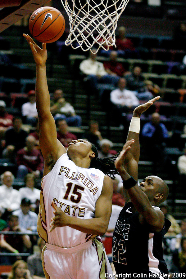 TALLAHASSEE, FL 11/3/09-FSU-DELTA BB09 CH07-Florida State's Terrance Shannon puts up a shot as Delta State's Marqueys Brown defends during first half action Tuesday at the Tallahassee-Leon County Civic Center. The Seminoles beat the Statesmen 81-38 in their first exhibition game of the season...COLIN HACKLEY PHOTO