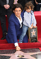 HOLLYWOOD, LOS ANGELES, CA, USA - APRIL 02: Orlando Bloom, Flynn Christopher Bloom at Orlando Bloom's star ceremony on the Hollywood Walk of Fame (2,521st star) in the category of Motion Pictures held at 6927 Hollywood Boulevard (next to TCL Chinese Theatre and Madame Tussauds Hollywood) on April 2, 2014 in Hollywood, Los Angeles, California, United States. (Photo by Celebrity Monitor)