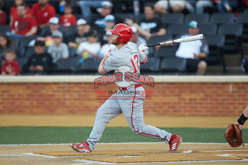 Brad Debo (12) of the North Carolina State Wolfpack follows through on his swing against the Wake Forest Demon Deacons at David F. Couch Ballpark on April 18, 2019 in  Winston-Salem, North Carolina. The Demon Deacons defeated the Wolfpack 7-3. (Brian Westerholt/Four Seam Images)