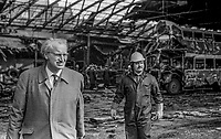 Werner Heubeck, chief executive, Ulsterbus/Citybus, left, at the scene of a Provisional IRA explosion at the Ulsterbus terminal in Winetavern Street, Belfast.  There was extensive damage but no injuries were sustained. 10th April 1972, 197204100293<br /><br />Copyright Image from Victor Patterson, 54 Dorchester Park, <br />Belfast, UK, BT9 6RJ<br /><br />t1: +44 28 9066 1296 (from Rep of Ireland 048 9066 1296)<br />t2: +44 28 9002 2446 (from Rep of Ireland 048 9002 2446)<br />m: +44 7802 353836<br /><br />victorpatterson@me.com<br />victorpattersonbelfast@gmail.com<br /><br />Please see my Terms and Conditions of Use at victorpatterson.com. It is IMPORTANT that you familiarise yourself with them.<br /><br />Images used on the Internet incur an additional cost and must be visibly watermarked i.e. &copy;Victor Patterson within the body of the image and copyright metadata must not be deleted. Images used on the Internet have a size restriction of 4kbs and are chargeable at rates available at victorpatterson.com.<br /><br />This image is available only for the use of the download recipient i.e. television station, newspaper, magazine, book publisher, etc, and must not be passed on to any third party. It is also downloaded on condition that each and every usage is notified within 7 days to victorpatterson@me.com<br /><br />The right of Victor Patterson (or the named photographer) to be identified as the author is asserted in accordance with The Copyright Designs And Patents Act (1988). All moral rights are asserted.