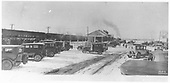 Shows depot scene with newer depot than the one in RD036-041.  Many motor cars.  Passenger train at station stop.  See RD036-051 for closer view.<br /> D&amp;RG  Delta, CO  Taken by Hammock, - ca 1917-1930