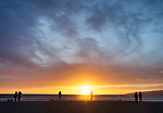 People on the beach at sunset in Santa Monica, CA