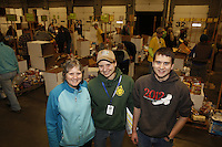 "Friday, February 15, 2013.   Pat Owens (L) who has been the lead volunteer for the ""people food"" drop since 1993,  poses with her daughter Mellissa and son Michael at the people food drop at Airland Transport in Anchorage."