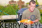 ROBBERY: Kelvyn Coyne from Abbeydorney with a Japanese Coy fish similar to those stolen from his pond last week.