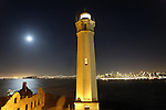 As the moon rises in the east as the lighthouse beans like to the city. A overnight pictorial on Alcatraz along with 30 photographers of Media Alliance Bay Area  in San Francisco California.