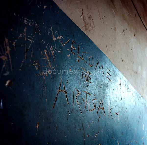 """""""welcome to Artsakh"""" written on the wall of a building in Stepanakert."""