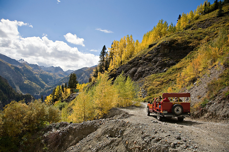 Jeeps travel on a dirt road near Savage Basin outside of Telluride, Colorado