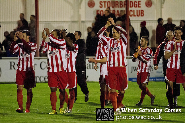 Stourbridge 4 Biggleswade Town 1, 09/11/2013. War memorial Athletic Ground, FA Cup First Round. Home players celebrating their team's victory at the end of Stourbridge FC's match against visitors Biggleswade Town FC (green shirts) at the War memorial Athletic Ground in the FA Cup first round, a stadium which also doubles as a cricket ground. The match was won by the home side by four goals to one, watched by a capacity crowd of 1605. It was Biggleswade's first appearance at the first round stage of the cup, winners Stourbridge went on to play Stevenage in the second round. Photo by Colin McPherson.