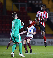 Lincoln City U18's Jordan Adebayo-Smith vies for possession with South Shields U18's Jacob Bramley<br /> <br /> Photographer Andrew Vaughan/CameraSport<br /> <br /> The FA Youth Cup Second Round - Lincoln City U18 v South Shields U18 - Tuesday 13th November 2018 - Sincil Bank - Lincoln<br />  <br /> World Copyright © 2018 CameraSport. All rights reserved. 43 Linden Ave. Countesthorpe. Leicester. England. LE8 5PG - Tel: +44 (0) 116 277 4147 - admin@camerasport.com - www.camerasport.com