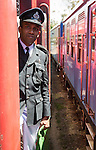 Male railway guard standing on a train Sri Lanka, Asia