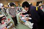Postman Yoshinori Shoji delivers a letter to a resident left homeless by the March 11 quake and tsunami at the KadonowakiJunior HighSchool in Ishinomaki, Miyagi Prefecture, Japan on Tuesday 24 May 2011..Photographer: Robert Gilhooly
