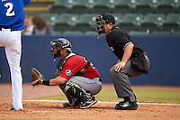 Birmingham Barons catcher Martin Medina (30) and umpire David Arrieta during a game against the Biloxi Shuckers on May 24, 2015 at Joe Davis Stadium in Huntsville, Alabama.  Birmingham defeated Biloxi 6-4 as the Shuckers are playing all games on the road, or neutral sites like their former home in Huntsville, until the teams new stadium is completed.  (Mike Janes/Four Seam Images)