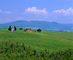 Tuscany, Italy, <br /> Capella di Vitaleta, a chapel among the farms and green rolling hills of Val d'Orcia near the hill town of Pienza