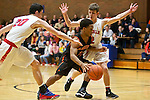Gladstone guard Handsome Smith (11) splits La Salle Prep defenders guard Luke Kolln (20) and guard Michael Edwards (2) in the first half at La Salle High School.<br /> Photo by Jaime Valdez