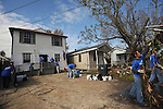 Employees of Freddie Mac from the Washington, D.C. area work on site finishing a home rebuilt after Hurricane Katrina in the Hollygrove section of New Orleans, Louisiana on March 11, 2008.