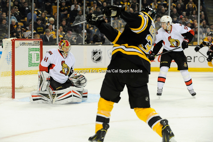 February 8, 2014 - Boston, Massachusetts, U.S. - Boston Bruins center Patrice Bergeron (37) shoots on Ottawa Senators goalie Craig Anderson (41)during the NHL game between the Ottawa Senators and the Boston Bruins held at TD Garden in Boston Massachusetts.   Eric Canha/CSM